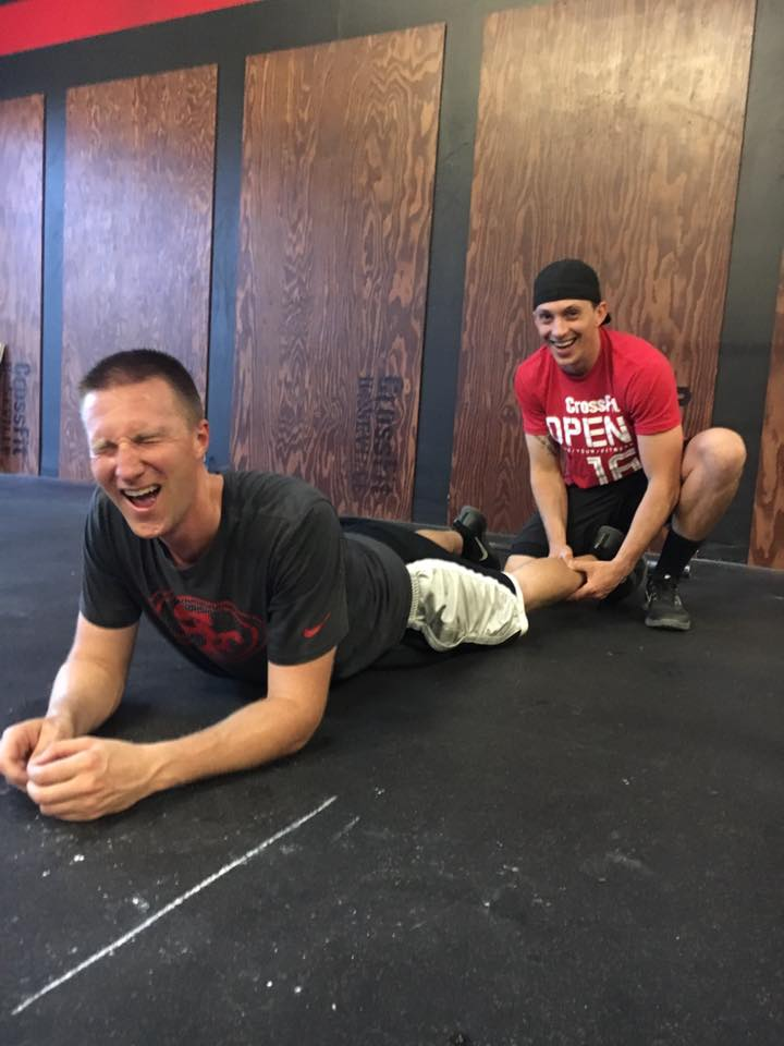 Coach Gary Showing Jeremy some Love at Roseville CrossFit